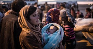 Kurdish refugee waits for transportation to a refugee camp after crossing into Turkey from Kobane on September 30, 2014 — Picture: Bryan Denton.